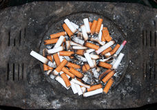 Public ash - tray. Public refuse bin for cigarette end outdoors Royalty Free Stock Images