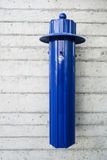 Public ashtray. Blue public ashtray at a entrence of a train station Stock Photo