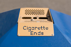 Public Ashtray - Cigarette Ends. A sign on a public litter bin, with the words Cigarette Ends Stock Photo