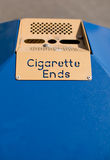 Public Ashtray - Cigarette Ends. A sign on a public litter bin, with the words Cigarette Ends Royalty Free Stock Image