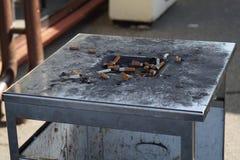 Public ashtray. Dirty city trashcan with ashtray on top stock photos