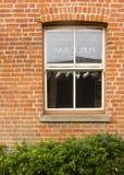Public Bar Sash Window. The elevation of the outside of the public bar and its sash window Stock Image