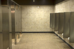 Public bathroom interiors. Clean and simple interiors of a bathroom in a mall Royalty Free Stock Image