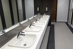 Public Bathroom. With mirrors and sink units Royalty Free Stock Photos