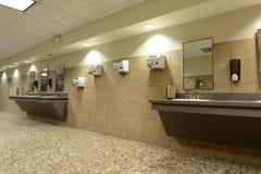 Public bathroom. Modern Public bathroom with creamic floors Stock Photos