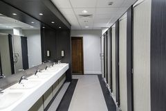Public Bathroom. For ladies with cubicles, mirrors and sink units Royalty Free Stock Photo