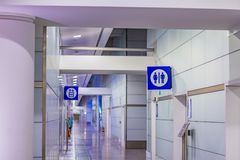 Public bathrooms entry. In modern building stock photography