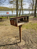 Public BBQ Grill in Harriman State Park, New York, USA. An example of a barbecue grill in a picnic area in Harriman State Park, New York, USA. Behind the grill Stock Photo