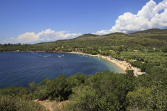 Public beach in the beautiful bay of the Aegean Sea. Royalty Free Stock Photos