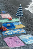 Public beach. In the early hours of the day already occupied by towels Royalty Free Stock Images