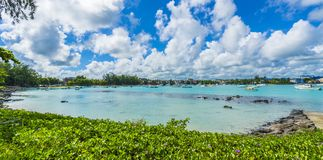 Public beach at Grand baie village on Mauritius island, Africa. Landscape with public beach at Grand baie village on Mauritius island, Africa stock image