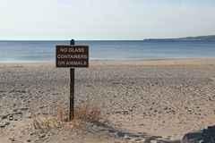 Public beach sign. Instruction sign on public beach. Michigan State Park. Beach is deserted Stock Image