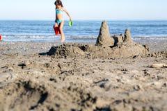 Public beach Strand. Building castle Stock Images