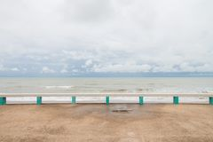 The public bench made with concrete at Muang Ngam Beach, Songkhla Province, Thailand.  Royalty Free Stock Images
