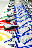 Public Bicycles parked on a street in line Royalty Free Stock Image