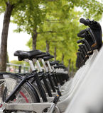 Public Bicycles for rent. At a docking station Stock Image
