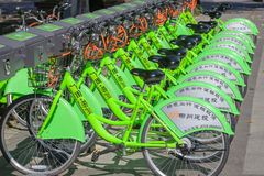 Public bicycles rental,Liuzhou,China. Public bicycles line up at a rental kiosk .Liuzou introduced a bike renting system,and will start operating during the Stock Images