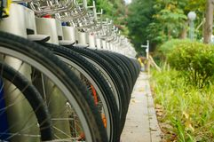 Public bike rental facilities and display of bicycle close-ups Royalty Free Stock Photography