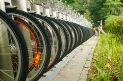 Public bike rental facilities and display of bicycle close-ups Royalty Free Stock Image