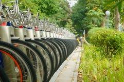 Public bike rental facilities and display of bicycle close-ups Stock Photos