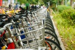 Public bike rental facilities and display of bicycle close-ups Royalty Free Stock Photos