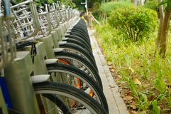 Public bike rental facilities and display of bicycle close-ups Royalty Free Stock Images