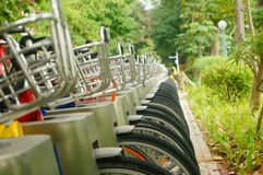 Public bike rental facilities and display of bicycle close-ups Stock Photography