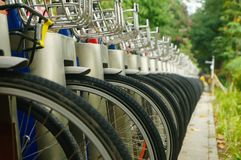Public bike rental facilities and display of bicycle close-ups Royalty Free Stock Photo