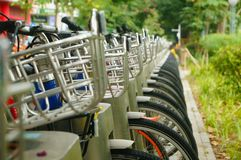 Public bike rental facilities and display of bicycle close-ups Stock Images