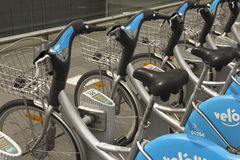 Public bike rental in Luxembourg. LUXEMBOURG MAY 2: close up of bikes locked at a public bike rental terminal run by the bike sharing company veloh in Luxembourg Stock Image