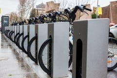 Public bike rental station. Madrid, Spain Royalty Free Stock Photo