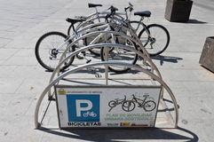 Public bikes. Public bicycles parked in the city of Merida, Spain Stock Image