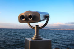 Public binoculars. Coin operated binocular standing on sea shore Royalty Free Stock Image
