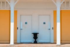 Public, boaters only, marina washrooms, toilet, wheelchair access, brightly colored building royalty free stock photo