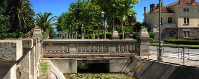 Public bridge. Bridge built in granite, near the urban street Stock Photo