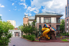Public brown house. With a children's playground next to it Royalty Free Stock Image