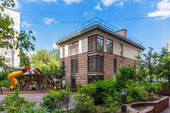 Public brown house. With a children's playground next to it Royalty Free Stock Photos