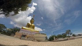 Public buddha statue in buddhist temple of Thailand , Time lapse Royalty Free Stock Image