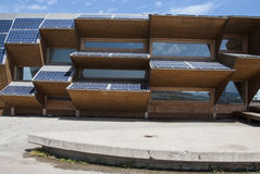 Public building made of solar panels, wood and mirror glass Stock Image