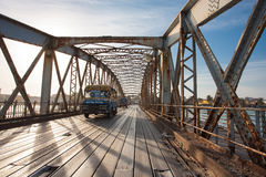 Public bus crossing the Faidherbe Bridge in Saint Louis Stock Image