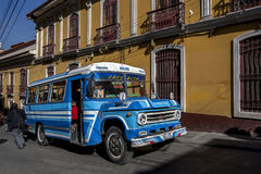 A public bus driving through the old town in La Paz in Bolivia. Royalty Free Stock Image