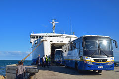 Public bus Fiji Searoad Service coming out from a large ferry at Natovi Landing nearby Suva, Fiji Stock Images