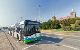 Public bus in front of the city's main attraction - Chrobry Embankment. Stock Photos
