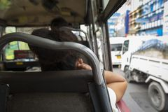 Public bus in jam. Scene of unidentified passengers in public omnibus of bangkok in traffic jan of Bangkok, Thailand Stock Photos