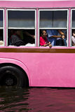 Public bus and passenger in flood Royalty Free Stock Photography