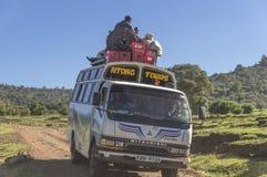 Public bus. People in a public bus in Kenya. A bus stop near National Park Masai marai Stock Images