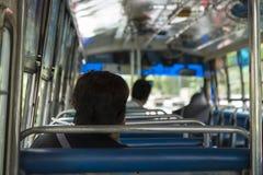 Public bus scene. Scene of unidentified passengers in empty public omnibus of Bangkok in Bangkok, Thailand Royalty Free Stock Photo