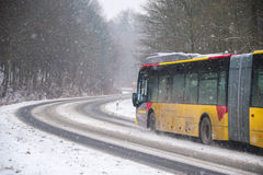 Bus on Winter road Stock Images