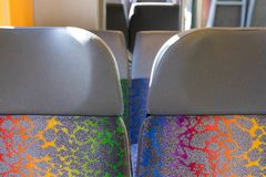 Public bus train chair seat colorful switzerland. Colorful seat in public transport bus train royalty free stock images