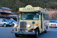 Public bus travelling around Kawaguchi lake Royalty Free Stock Photography